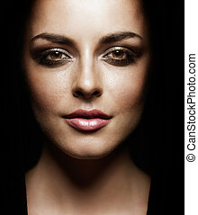 glamourous portrait of beautiful young woman wearing evening professional makeup. contrast image