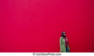 Glamor beautiful woman with scarf and sunglasses on red...