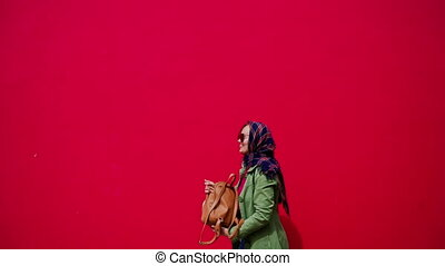 Glamor beautiful woman with scarf and sunglasses throws up a...