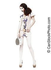 Glamor. Graceful Svelte Slim Woman in Trendy Dress and Handbag. Spring Time
