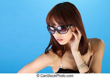 Glamor of modern woman of Asian, closeup portrait over blue...