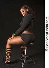 Glamorous African-American girl on stool