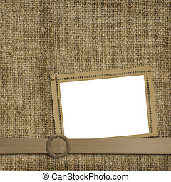 Glamorous belt with an old worn background of sackcloth