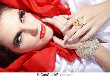 Glamorous brunette woman in red
