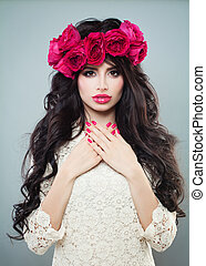 Glamorous Brunette Woman with Curly Hair, Makeup and Summer Flower