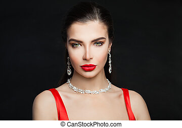 Glamorous brunette woman with jewelry diamond necklace and earrings, fashion portrait