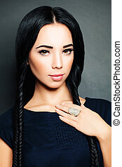Glamorous Brunette Woman with Long Hair. Braids Hairstyle