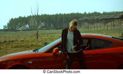 glamorous business Lady near sports car