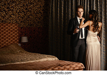 glamorous couple - Beautiful couple in love in bedroom. ...