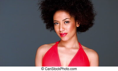 Glamorous elegant African American lady with a large frizzy...
