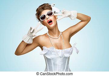Glamorous gape. - The retro photo of a glamorous bride with...