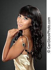Glamorous girl holding jewelery