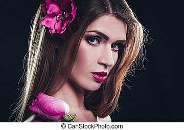 glamorous girl with long straight hair and a rose in her hand.