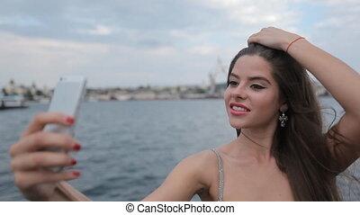 Glamorous girls doing photo on the phones