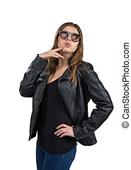 Glamorous hot young woman in a leather jacket and brown sunglasses, isolated on white background. Street, rock fashion style.