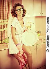 glamorous housewife - Glamorous sexy pin-up girl washing the...