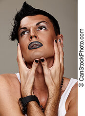 Glamorous man - Closeup portrait of a male model with makeup...