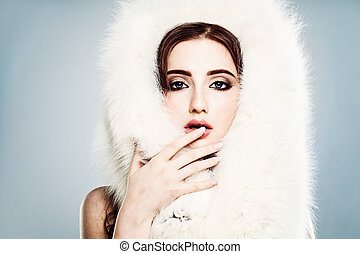 Glamorous Model Woman with White Fur and Makeup