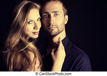 glamorous pair - Portrait of a beautiful young couple in ...