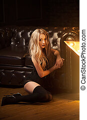 glamorous photo of a beautiful blonde in black