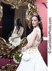 glamorous photo of a beautiful brunette bride in hotel