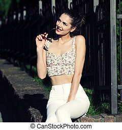 glamorous portrait of young woman in sunglasses. Lifestyle outdoor portraitglamorous portrait of young woman in sunglasses. Lifestyle outdoor portrait