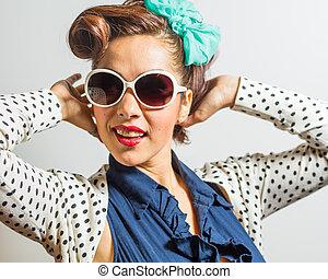 Glamorous pretty female in rockabilly style