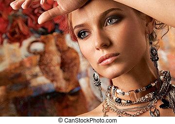 A portrait of a glamorous woman wearing beautiful jewelery