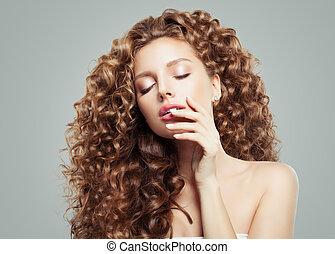 Glamorous woman fashion model portrait. Beautiful girl with long curly hair