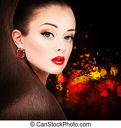 Glamorous Woman Fashion Model with Long Hairstyle, Red Lips Makeup and Earrings on Night Party Background