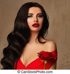 Glamorous Woman Fashion Model with Long Permed Hairstyle, Red Lips Makeup and Red Rose Flower