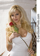 Glamorous woman Holding a Rose