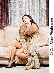 Glamorous woman in a fur coat