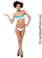 Glamorous woman in swimwear presenting copy space - Stunning...