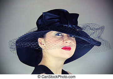 glamorous woman in the hat