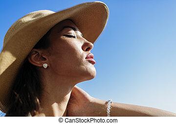 Glamorous woman looking towards the sun