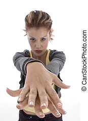 glamorous woman making hand gesture