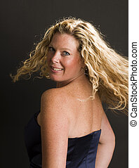 glamorous woman posing in cocktail dress