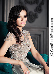 Glamorous Woman Posing on Background