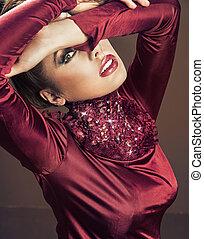 Glamorous woman wearing maroon dress