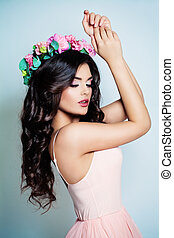 Glamorous Woman wearing Pink Dress. Fashion Model with Flowers Wreath