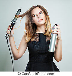 Glamorous Woman with Blonde Wavy Hair Ironing It, Using Curling Iron