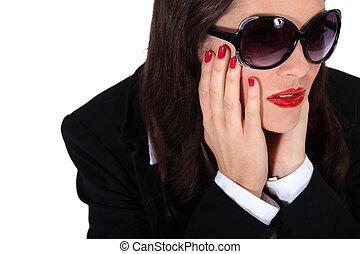 Glamorous woman with flashy make-up