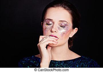 Glamorous Woman with Glitters Makeup. Beautiful Face