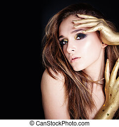 Glamorous Woman with Golden Makeup on Black Background