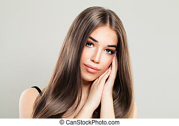 Glamorous Woman with Natural Brown Hair and Perfect Skin. Beautiful Model with Long Healthy Hair