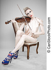 Glamorous woman with violin
