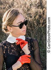 woman in orange gloves