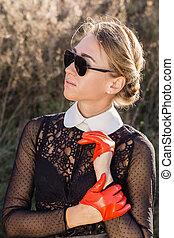 beautiful woman in orange gloves