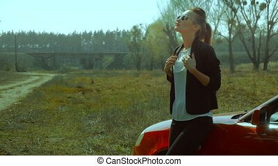 standing near a car in the Meadow